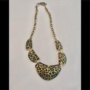 Gold tone leopard print necklace